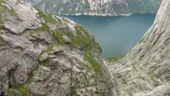 Base jumper jumping of a cliff for an extreme sport Stock Footage