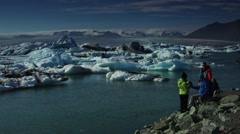 Tourist looking the glacier Stock Footage