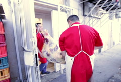 Butchers carrying carcass Stock Footage
