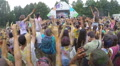 Slow motion young people jumping waving hands at music event, click for HD Footage