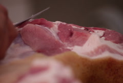 Butcher removing fat off pig loin Stock Footage