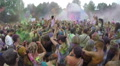 Spraying colored powder paint among crowd, festival slow motion, click for HD Footage