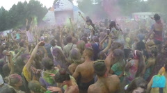 Sprinkling colored powder in crowd, dancing people, slow-motion, click for HD Stock Footage