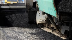 Tracked machine for paving apply asphalt to road. Road works. Close up. 25 fps. - stock footage