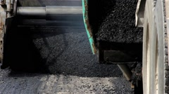Spillage of asphalt on the street. Machine for paving pouring asphalt to road. - stock footage