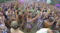 Positive people waving hands to music at concert, spraying paint, click for HD Footage