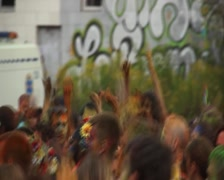 Young happy people dancing, waving hands to music at fest, click for HD Stock Footage