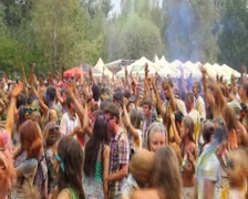Dancing crowd covered in colorful paint, people enjoying fest, click for HD Stock Footage