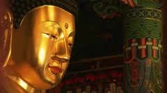Giant Buddha statue in temple Stock Footage