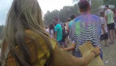 Young people covered in paint having fun at festival, slow-mo, click for HD Stock Footage