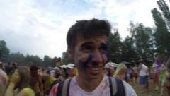 Young man's face covered in paint, emotions, festival atmosphere, click for HD - stock footage