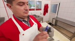 Butcher checking  verifying tools Stock Footage
