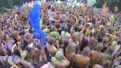 Happy crowd throws paint powder in air, festival atmosphere, click for HD Stock Footage