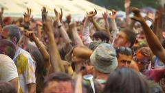 Young guys, girls dancing at festival, waving hands to music, click for HD Stock Footage