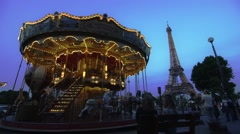 Romantic carousel in front of the Eiffel Tower in Paris Stock Footage
