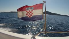 The flag of Croatia blowing in the wind on a boat Stock Footage