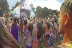 Slow motion, crowd putting hands up in air, festival atmosphere, click for HD Stock Footage
