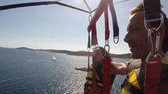 Parasailing above the Mediterranean sea - stock footage
