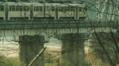 Train going over bridge from South Korea to North Korea Stock Footage