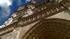 Front view of Notre Dame de Paris, panning, UHD quality Stock Footage