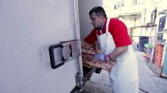 Butcher preparing beef carcass Stock Footage