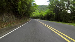 Car travels down the twisting roads Stock Footage