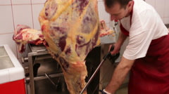 Butcher cutting veal plate Stock Footage