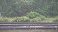 ULTRA HD 4K Aerial view rain fall cloudy day infrastructure railway forest tree  - stock footage