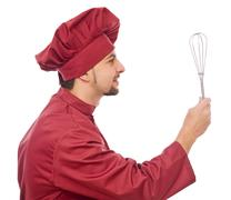 Profile of chef with egg beater wire rods Stock Photos