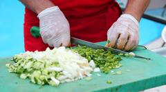 Stock Photo of Chef Chopping Vegetables