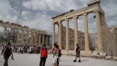 People near Parthenon - ancient temple in Athenian Acropolis, Greece Stock Footage