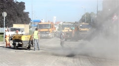 Stock Video Footage of Roadwork. Dust rising into the air. Workers with compressor cleaning the street.