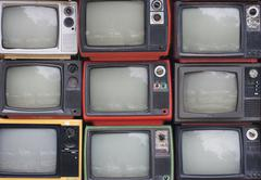 a wall of old vintage tube televisions - stock photo