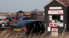 Busy seaside car park at Winterton in Norfolk Stock Footage