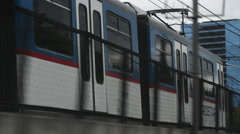 Pacing an Metro Rail train, stock video clip Stock Footage