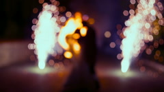 The dance two lovers newlyweds on background of the fiery show Stock Footage