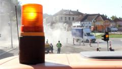 Flashing light. Rotating beacon of the vehicle. Workers cleaning street. 25 fps. Stock Footage