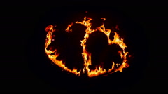 Heart made of fire on black background Stock Footage