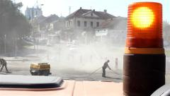 Rotating beacon of the vehicle. Workers with compressor cleaning street. 25 fps. Stock Footage