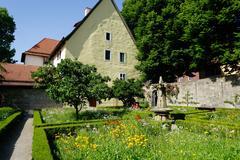 the cloister garden, rothenburg ob der tauber, romantic road, franconia, bava - stock photo