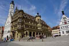 the double town hall in the market square in rothenburg ob der tauber, romant - stock photo