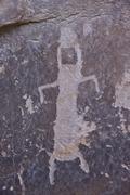 humanoid petroglyph on the kohta circus petroglyph panel, gold butte, nevada, - stock photo