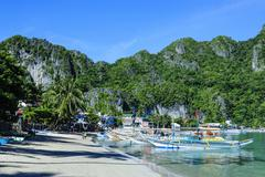 the bay of el nido with outrigger boats, bacuit archipelago, palawan, philipp - stock photo