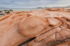 Wind-eroded sandstone rock formations in el gato bay, baja california sur, me Stock Photos