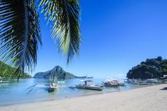 The bay of el nido with outrigger boats, bacuit archipelago, palawan, philipp Stock Photos
