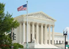 United states supreme court with flag Stock Photos