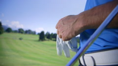 Golfer wearing a glove Stock Footage