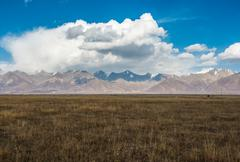 Incredible color of the sky and clouds over flat tibetan plain Stock Photos