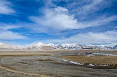Stock Photo of high altitude tibetan plateau and cloudy sky at qinghai province
