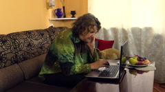 Senior grandma woman work with laptop notebook computer at home Stock Footage